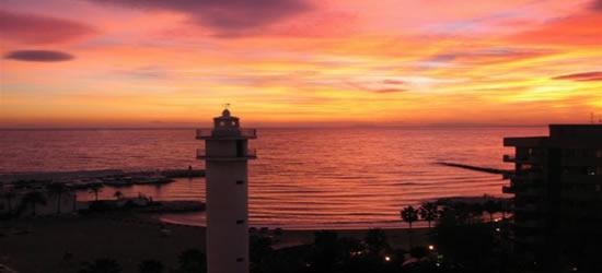 Espectacular puesta de sol, con entrada al puerto